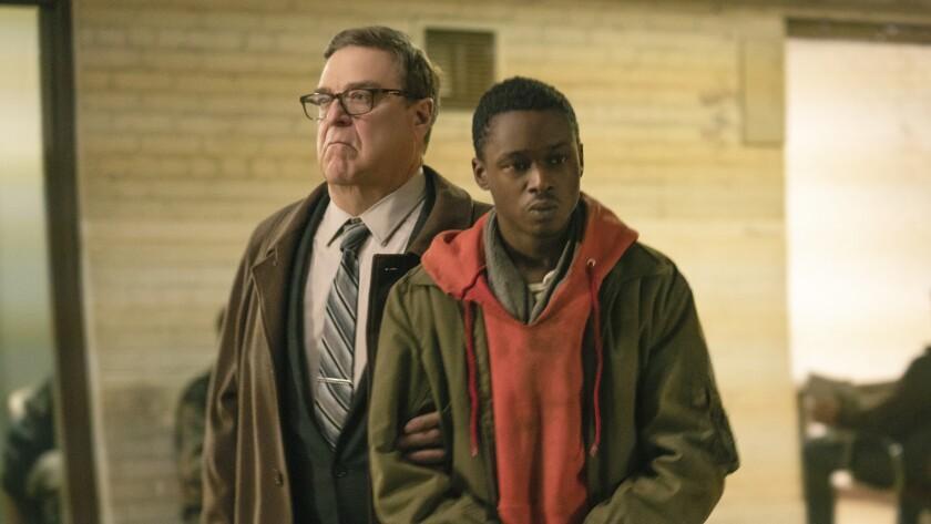 "John Goodman, left, and Ashton Sanders in the movie ""Captive State."""