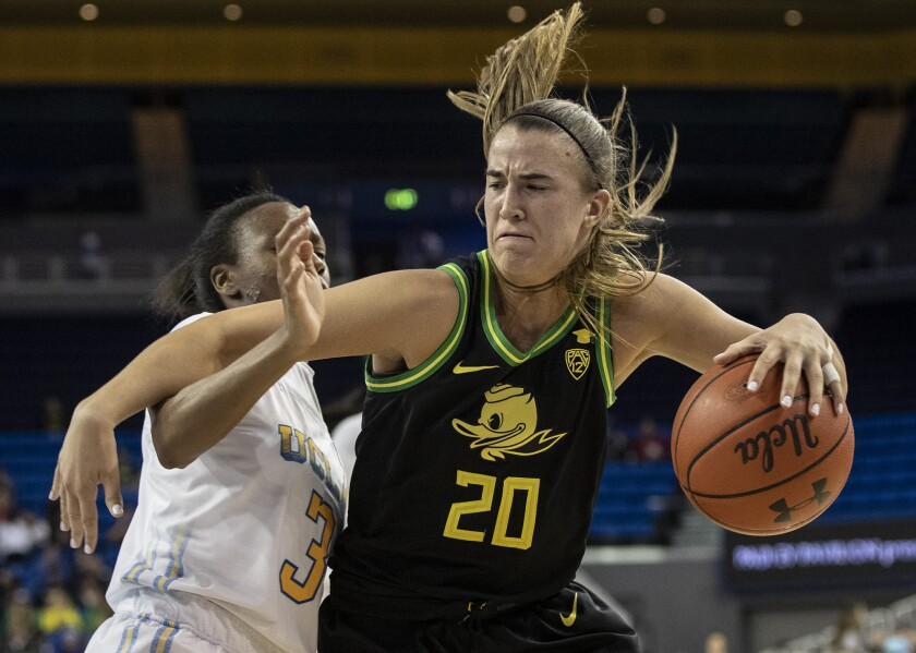 Oregon guard Sabrina Ionescu, shown driving to the basket against UCLA on Feb. 14 at Pauley Pavilion, is the consensus No. 1 pick for the WNBA draft on April 17.