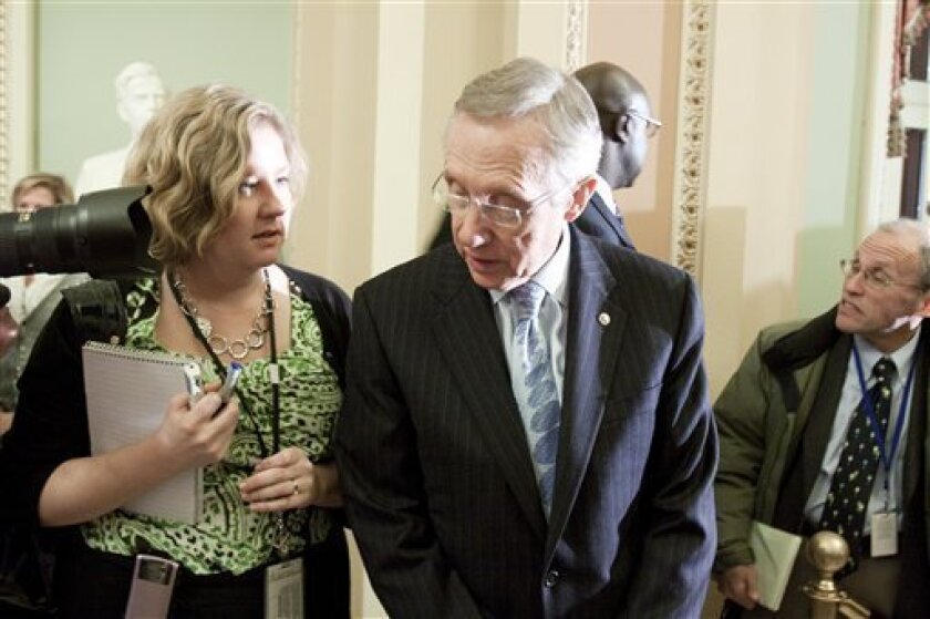 Senate Majority Leader Harry Reid, D-Nev., is seen before his weekly news conference on Capitol Hill, Tuesday, Dec. 8, 2009, in Washington. (AP Photo/Harry Hamburg)