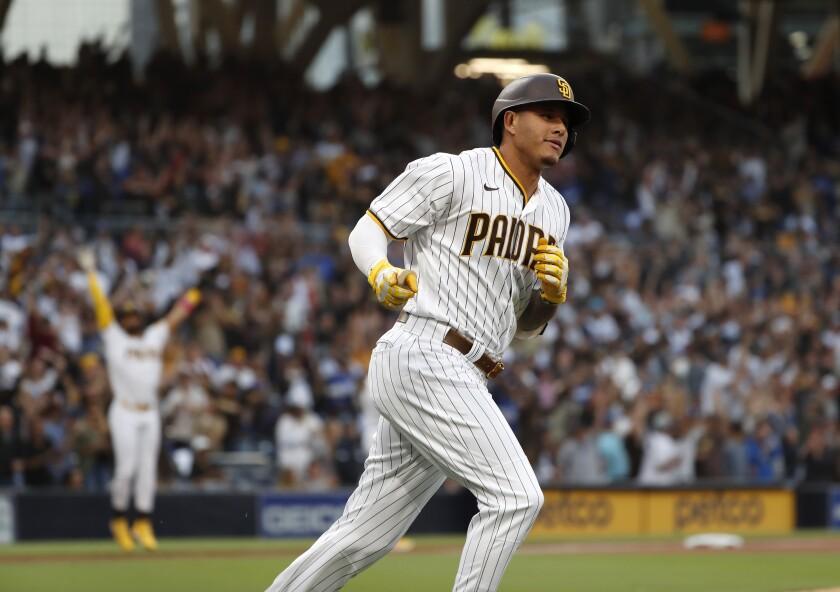 Manny Machado rounds first base after hitting a three-run homer