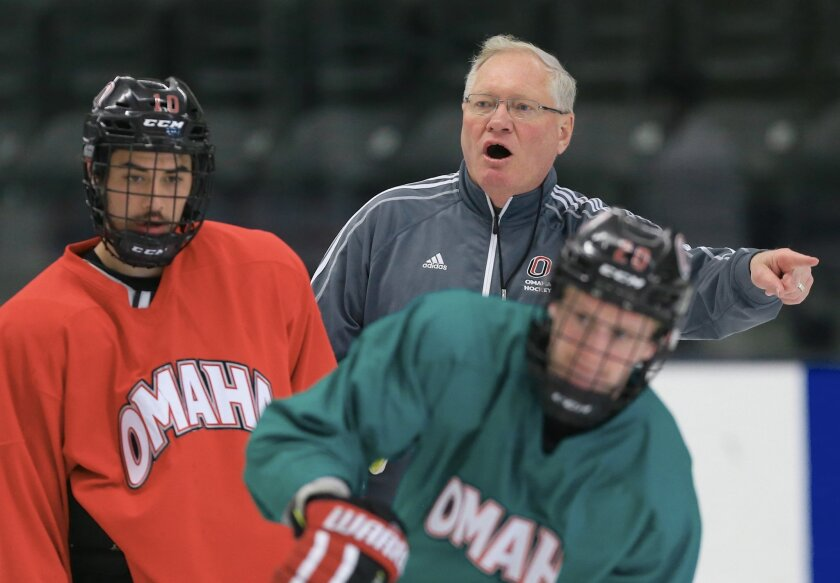 In this April 3, 2015 photo, Omaha's NCAA college hockey coach Dean Blais calls a drill during practice in Omaha, Neb. Blais is in his fourth NCAA Frozen Four, this time with a young Nebraska-Omaha team that's making its first appearance in the program's 18-year history. (AP Photo/Nati Harnik)
