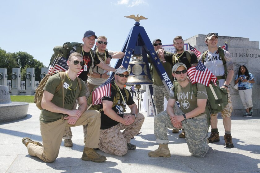 Servicemen pose for a photo with the Freedom Bell at the National Mall in Washington, D.C. Courtesy photo