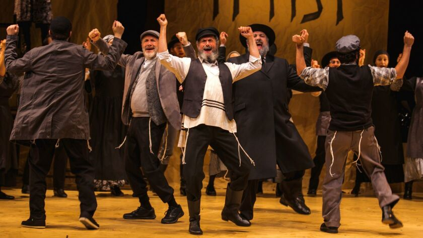 "Steven Skybell, center, and ensemble in the Yiddish version of ""Fiddler on the Roof."""