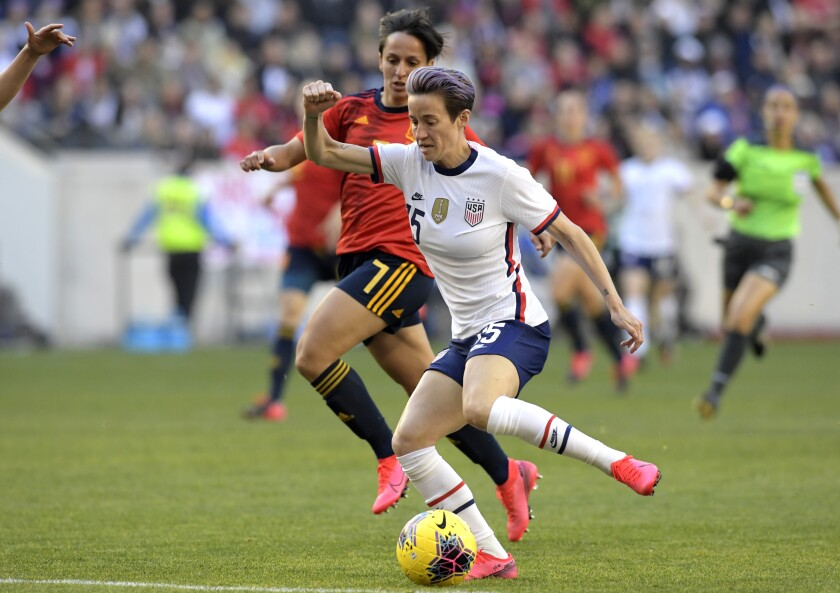 United States forward Megan Rapinoe (15) controls the ball as she is pursued by Spain defender Marta Corredera (7) during the first half of a SheBelieves Cup soccer match Sunday, March 8, 2020, in Harrison, N.J. (AP Photo/Bill Kostroun)