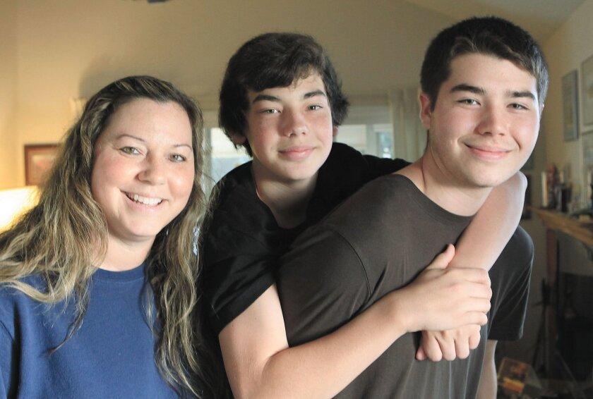 Deanna Kremis, left and sons  Trevin Kremis, 13 and Matthew Kremis, 17, have all undergone heart transplants.