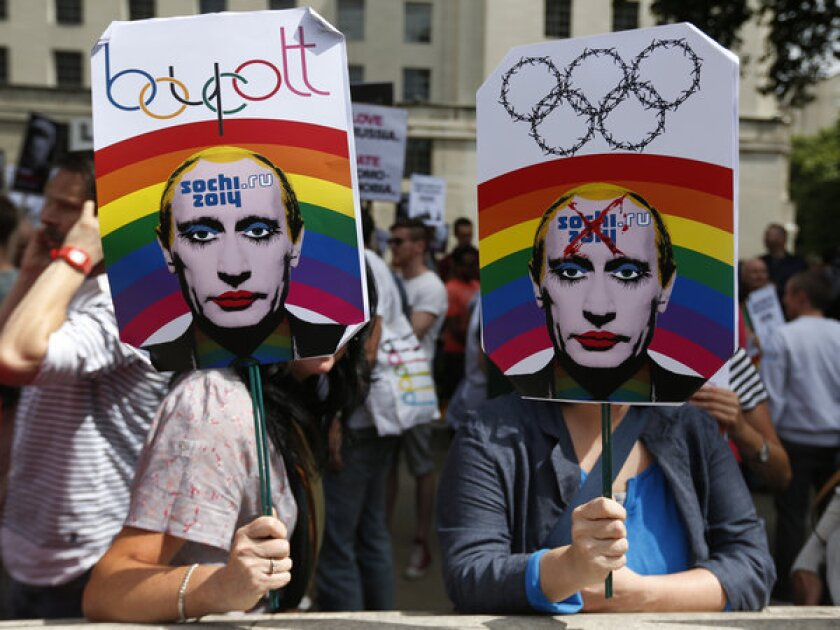 Hundreds of gay rights activists protested in London on Saturday, brandishing doctored images of Russian President Vladimir Putin as they called for boycotting the 2014 Olympic Winter Games in Sochi in protest of a law targeting gays.
