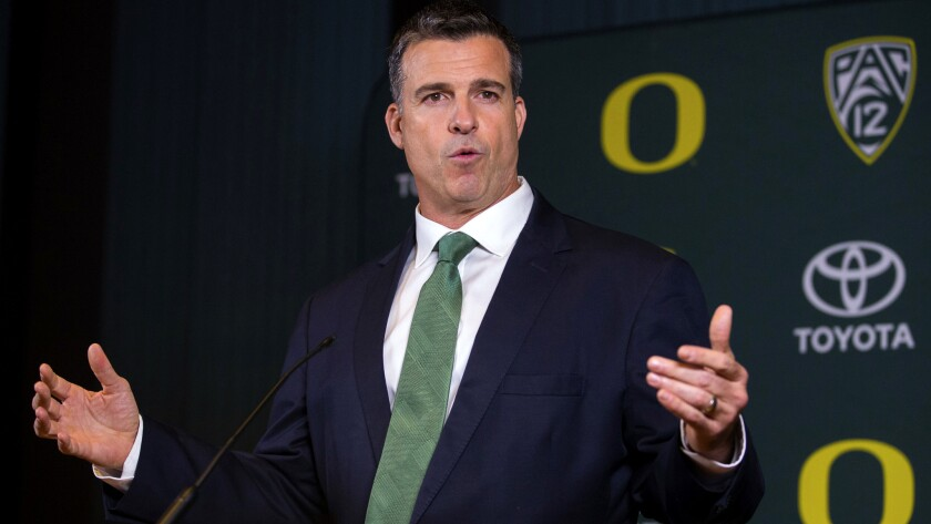 Mario Cristobal talks to reporters after being introduced as Oregon football coach Friday, Dec. 8, 2