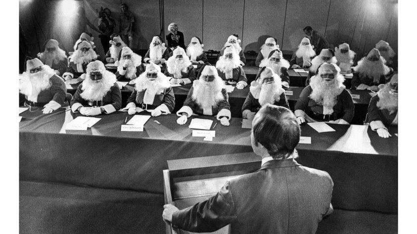Nov 24, 1976: Twenty-eight members of the Sears Roebuck Santa Claus school get some final tips before they begin a four-week stints as St. Nick.