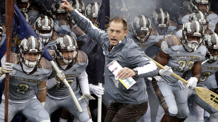 Western Michigan Coach P.J. Fleck leads his team onto the field before a game against Buffalo on Nov. 19.