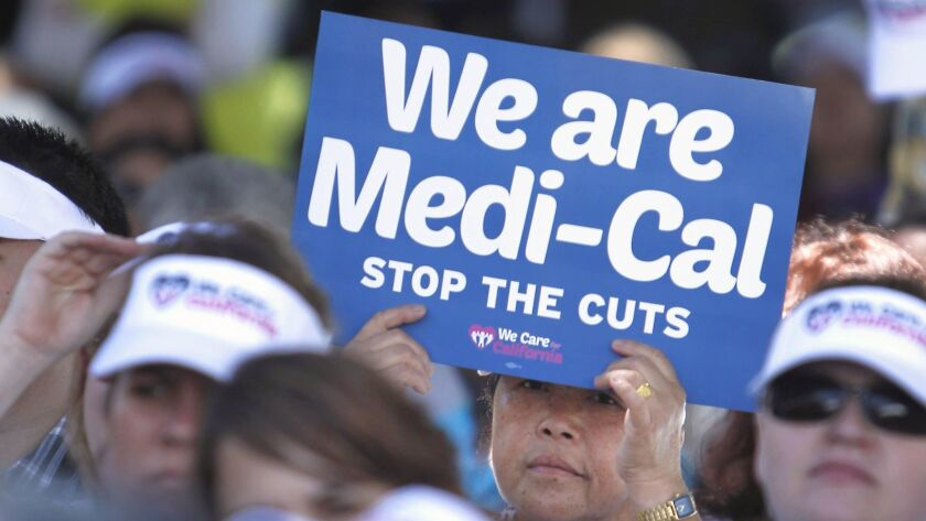 In this June 4, 2013 file photo, demonstrators representing doctors, hospitals and unionized health care workers rallied against cuts to Medi-Cal reimbursements at the Capitol in Sacramento. Proposition 52 would firm up Medi-Cal funding.