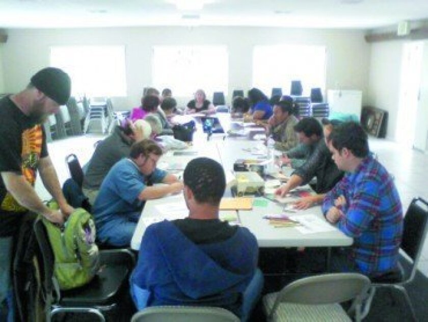Youth and adults with special needs creating artwork at the Community Hall.