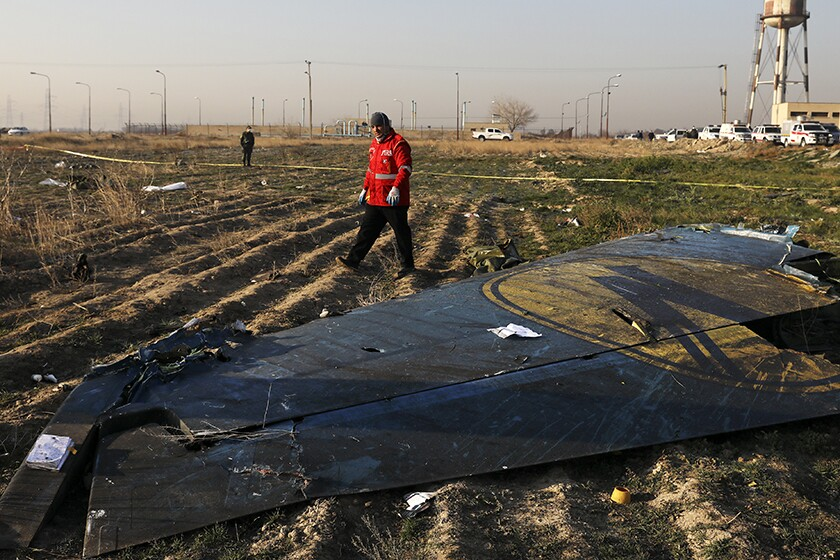 A rescue worker at the scene of the plane crash near Tehran on Wednesday.