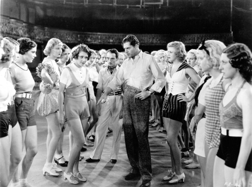"Una Merkel, from left-center, Ruby Keeler, George E. Stone, Warner Baxter and Ginger Rogers in the 1933 movie ""42nd Street."""