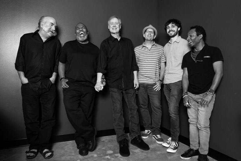 Keyboard star Bruce Hornsby (third from left) and his band The Noisemakers, which now features San Diego-bred violinist John Mailander (second from right).