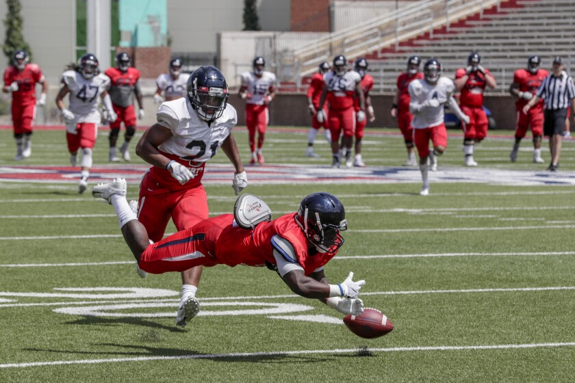 Liberty University receiver Shedro Louis misses a catch in front of defensive back Marcellous Harris during an intrasquad scrimmage at Williams Field.