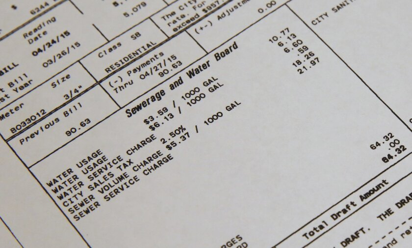 ADVANCE FOR SATURDAY, SEPT. 26, AND THEREAFTER - This Sunday, Jan. 20, 2015, photo, shows a detail of a water bill showing usage and rates in New Orleans. With all the questions surrounding the nation's water supplies and systems, one thing seems certain: Customers will be paying more to keep their taps flowing. (AP Photo/Jonathan Bachman)