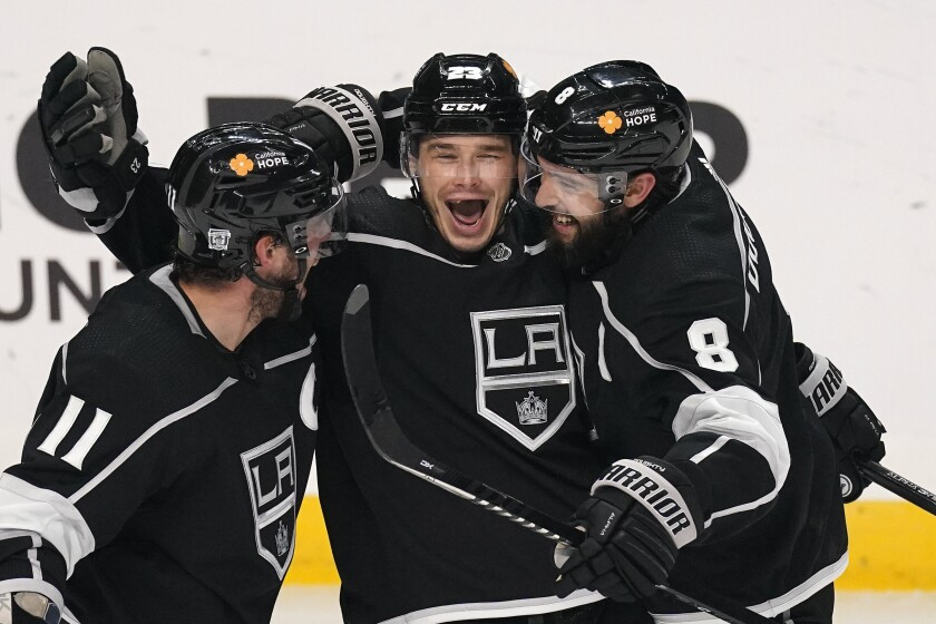 Kings forward Dustin Brown celebrates with Anze Kopitar and Drew Doughty after scoring against the Minnesota Wild.