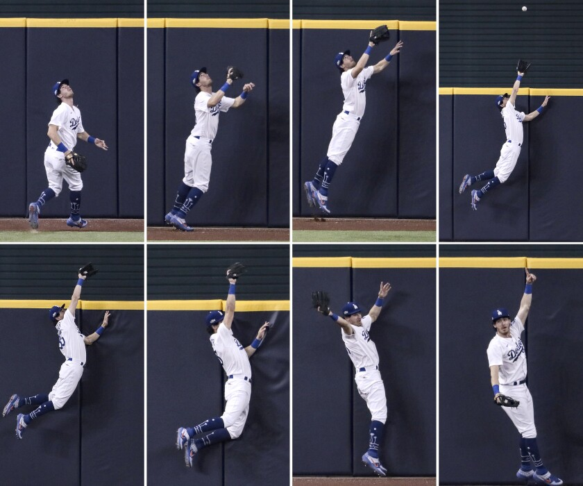 Dodgers center fielder Cody Bellinger robs Fernando Tatis Jr. of a seventh inning homer.