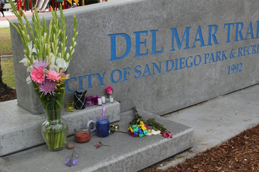 Memorials were left at the site where a Carmel Valley jogger was struck by a car April 30. Photo by Karen Billing