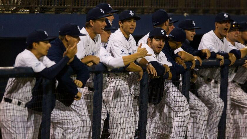 The USD bench cheers after the first out against Vanderbilt.