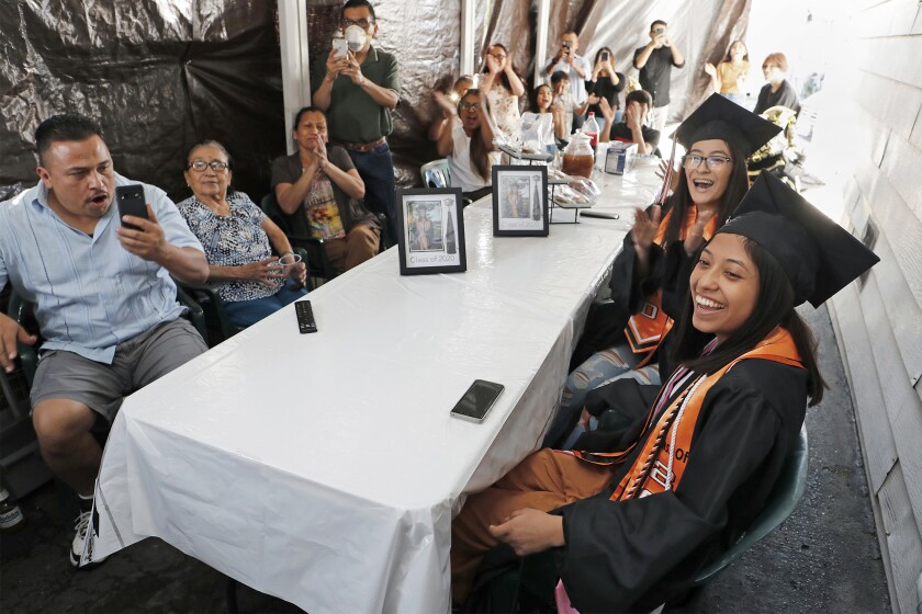 Alexandra Lopez, 17, bottom right, is celebrated by family and friends as they watch Los Amigos' virtual graduation Friday.