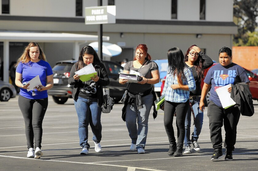 At Everest College-Alhambra, which had been abruptly shut down, students leave the campus with paperwork given to them by the State Department of Consumer Affairs.