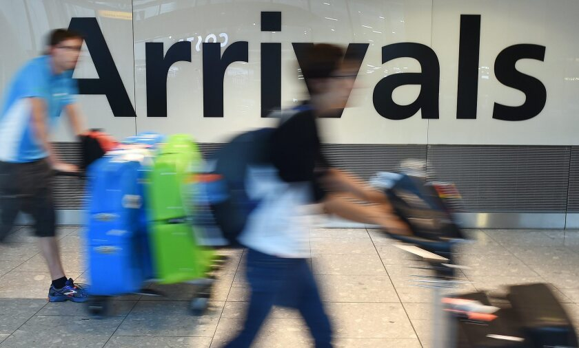 Passengers arrive at Heathrow Airport in London, where enhanced screening for Ebola began this week.