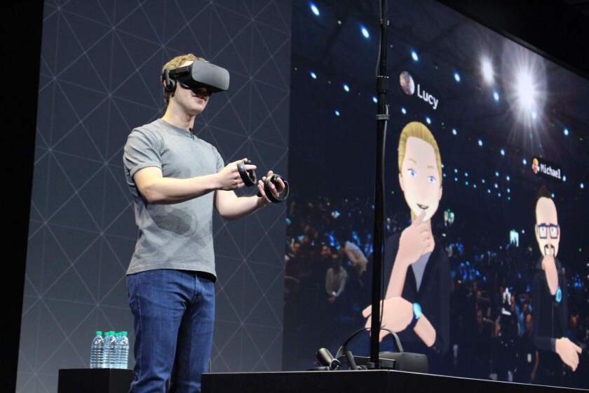 Facebook CEO Mark Zuckerberg speaks at an Oculus developers conference in San Jose while wearing a virtual reality headset.
