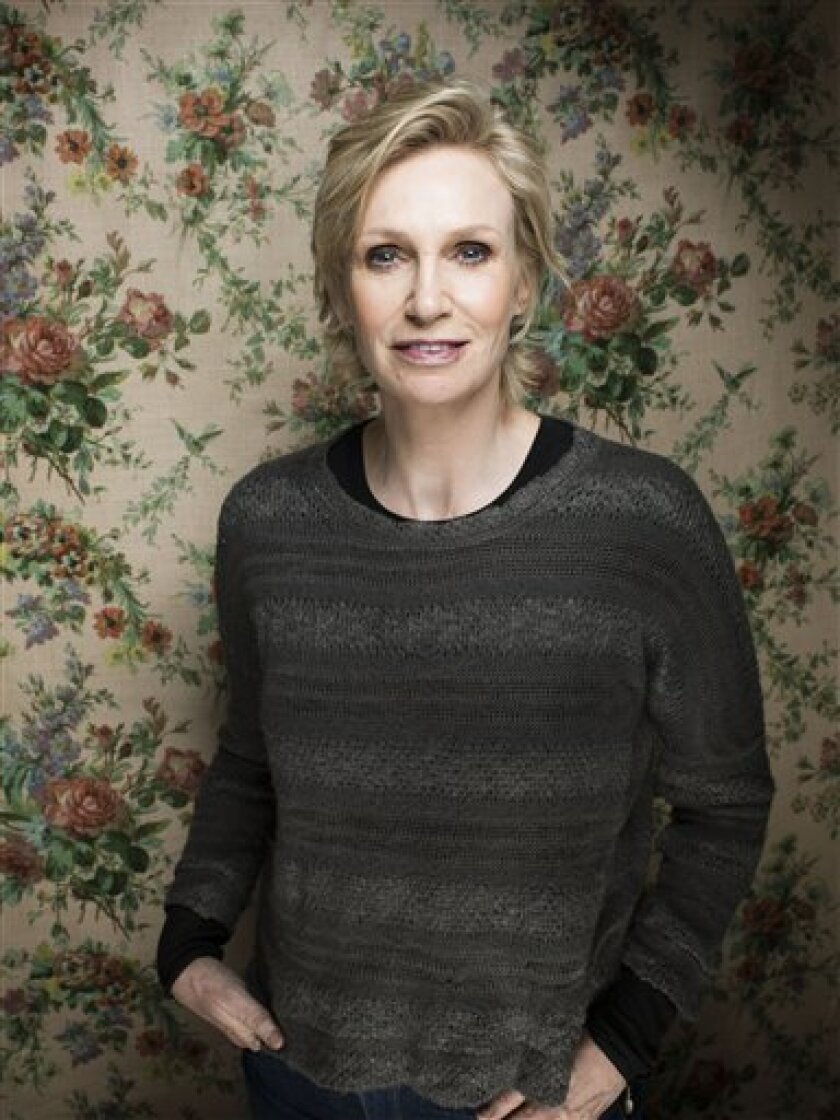 FILE - This Jan. 21, 2013 file photo shows actress Jane Lynch during the 2013 Sundance Film Festival at the Fender Music Lodge in Park City, Utah. Lynch said Wednesday, Feb. 20, she'll be replacing Tony Award-winning actress Katie Finneran as the evil orphanage matron Miss Hannigan in the current r