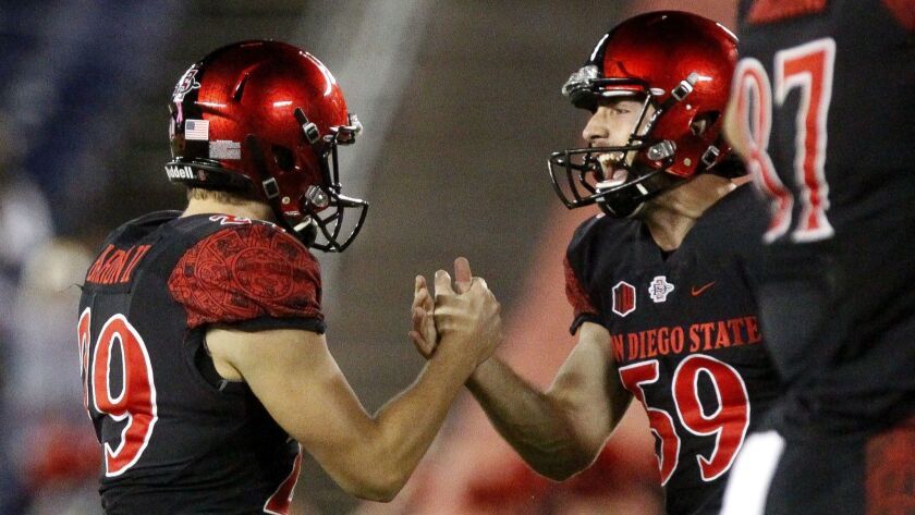 San Diego State place-kicker John Baron II (left) celebrates with holder Brandon Heicklen after Baron booted a 51-yard field goal in the fourth quarter