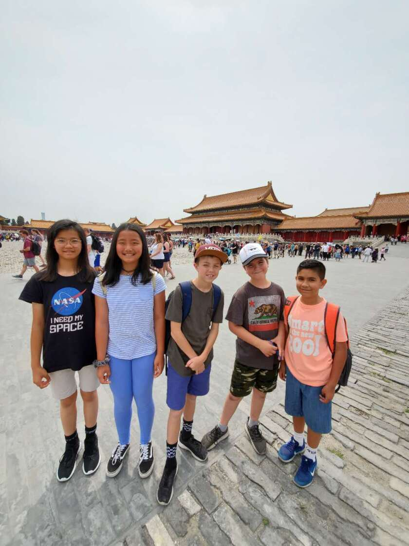 A group of students within the Forbidden City (or Palace Museum)