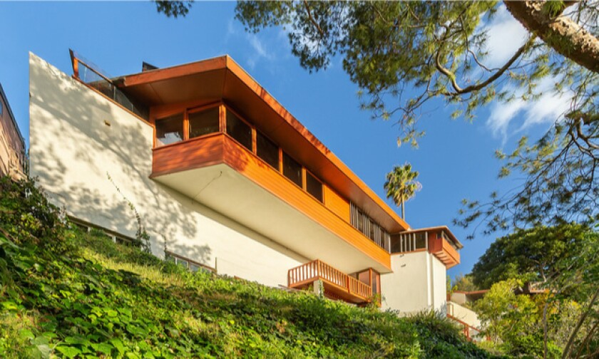 Descending three stories down a hillside lot, the John Lautner-designed home holds three bedrooms in 1,200 square feet.