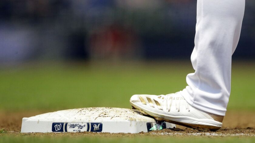 The cleats of Milwaukee Brewers' Ryan Braun are seen during the sixth inning of a baseball game agai