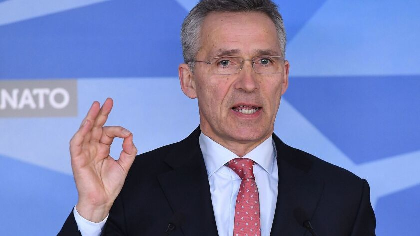 NATO Secretary-General Jens Stoltenberg addresses the press at NATO headquarters in Brussels on March 27, 2018.
