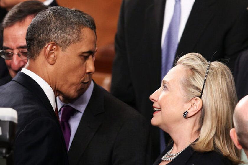 President Obama greets Secretary of State Hillary Rodham Clinton at his State of the Union address on Tuesday.