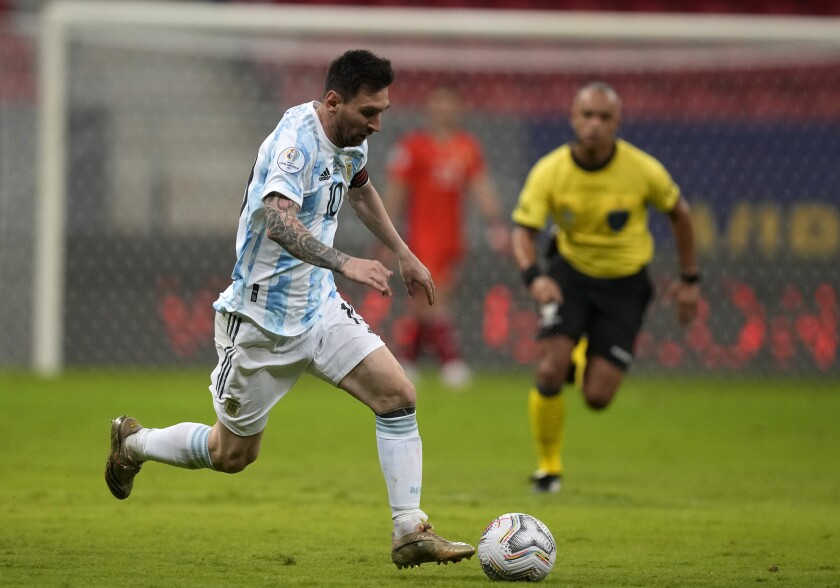 Argentina's Lionel Messi controls the ball during a Copa America soccer match against Uruguay at National stadium in Brasilia, Brazil, Friday, June 18, 2021. (AP Photo/Ricardo Mazalan)