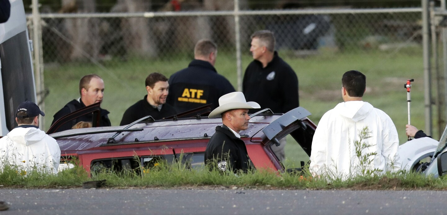 Officials investigate the scene where a suspect in a series of bombing attacks in Austin, Texas, blew himself up near Round Rock as authorities closed in.