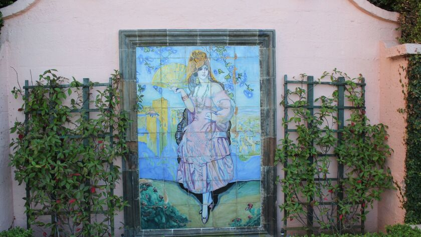 Although many locals believe La Valencia hotel's nickname 'Pink Lady' orginates from the color of its stucco, the first lady in pink was this 1928 tile portrait of a Spanish maiden in traditional dress by Ernest Batcheler, which has lived at the complex for almost 90 years.