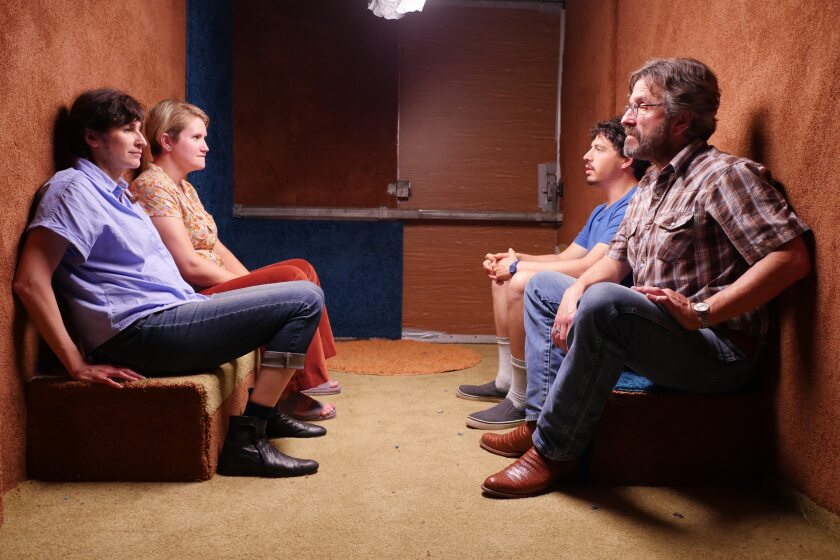 "Michaela Watkins, left, Jillian Bell, Jon Bass and Marc Maron in the movie ""Sword of Trust."""