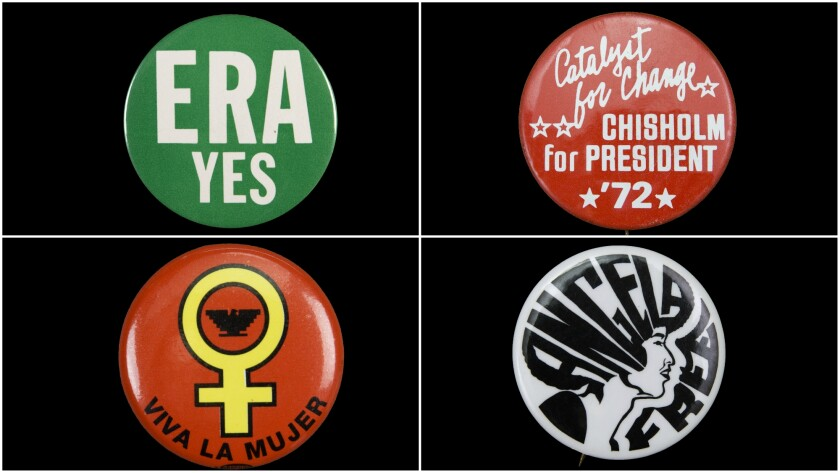 Four vintage political buttons in green, white and red feature slogans and graphic elements in support of women's causes