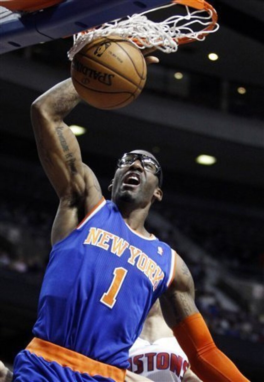New York Knicks forward Amare Stoudemire (1) dunks against the Detroit Pistons during the first half of an NBA basketball game Wednesday, March 6, 2013, in Auburn Hills, Mich. (AP Photo/Duane Burleson)