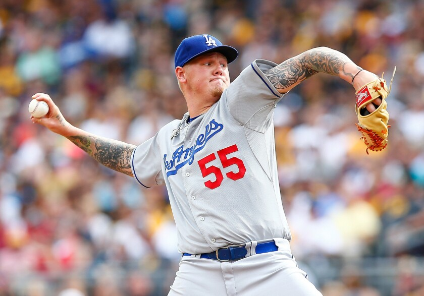 Dodgers starter Mat Latos gave up six runs in four innings of work against the Pirates on Saturday in Pittsburgh.