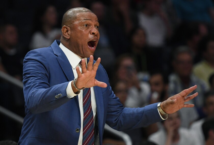 Clippers coach Doc Rivers instructs his players.