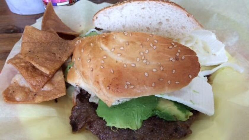 A cemita with a pounded sheet of beef bigger than the bun.