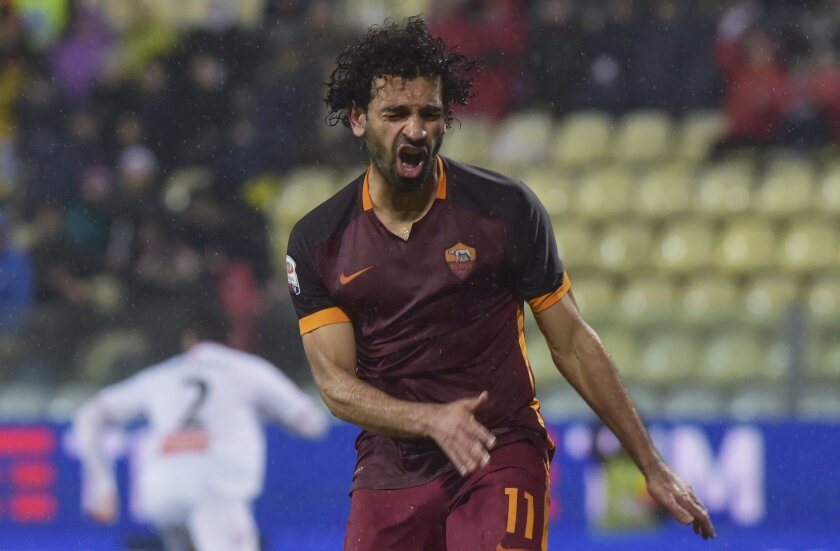 Roma's Mohamed Salah reacts after his shot hit the post during their Serie A soccer match against Carpi, at Modena's Braglia stadium, Italy, Friday, Feb. 12, 2016. (AP Photo/Marco Vasini)