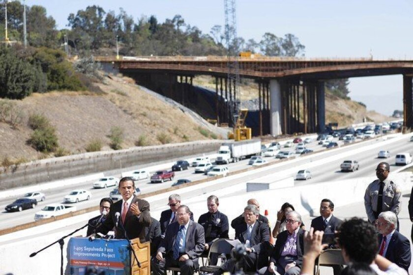 Los Angeles Mayor Antonio Villaraigosa speaks at a news conference along the 405 Freeway on Thursday about the freeway's closure during the last weekend in September. Other city, county, transportation and public safety officials are behind him.