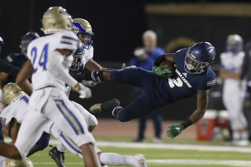 Sierra Canyon's DJ Harvey gets airborne after a catch and run