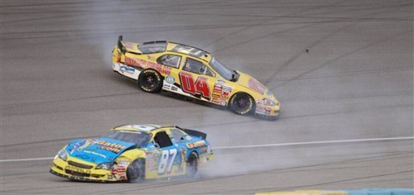 NASCAR drivers Jeremy Clements (04) and Joe Nemechek (87) come to a stop after slamming into each other and the wall during the NASCAR Nationwide Ford 300 auto race Saturday, Nov. 20, 2010, at Homestead-Miami Speedway in Homestead, Fla.(AP Photo/Alan Diaz)