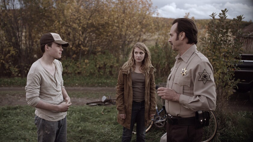 """Josh Wiggins, from left, Sophie Nélisse and Bill Paxton in the film """"Mean Dreams."""""""
