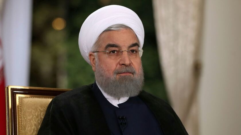 In this photo released by the official website of the office of the Iranian Presidency on Tuesday, A